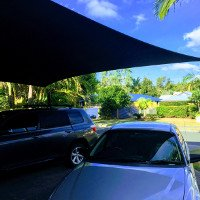 This shade sail was designed to cover the customers driveway to protect their vehicles from the harsh elements.